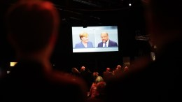 File Photo: German Chancellor Angela Merkel (L) and the leader of the Social Democratic Party (SPD)  Martin Schulz (R), are seen on a screen during the TV debate in a TV studio in Berlin, Germany. EPA, CARSTEN KOALL