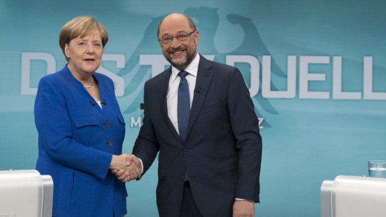 A handout picture released by German TV broadcaster WDR shows German Chancellor Angela Merkel (L) of the Christian Democratic Union (CDU) and Martin Schulz (R), German Chancellor candidate and leader of the Social Democartic Party (SPD) shaking hands prior to their TV debate in Berlin, Germany, 03 September 2017. German federal elections will be held on 24 September 2017. EPA, HERBY SACHS WDR / POOL