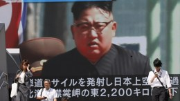 Pedestrians walk under a large-scale monitor displaying North Korean leader Kim Jong-un on a TV news broadcast in Tokyo, Japan, 15 September 2017. Earlier in the day, North Korea launched a ballistic missile over Japan that reportedly crashed in the Pacific Ocean, more than 2,000km east of the Japanese northern island of Hokkaido. According to reports quoting the South Korean and Japanese governments, the missile was purportedly fired from the North's capital Pyongyang. At the request of the USA and Japan, the United Nations (UN) Security Council will meet on 15 September. EPA, KIMIMASA MAYAMA