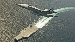 A handout photo made available by the US Navy shows an F/A-18F Super Hornet assigned to Air Test and Evaluation Squadron (VX) 23 flying over the USS Gerald R. Ford (CVN 78), at sea. EPA/US NAVY/ERIK HILDEBRANDT HANDOUT HANDOUT EDITORIAL USE ONLY/NO SALES