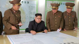 FILE PHOTO. A picture released by the North Korean Central News Agency (KCNA) North Korean leader Kim Jong Un inspecting plans to fire missiles towards the US Pacific territory of Guam at the Command of the Strategic Force of the Korean People's Army (KPA), Pyongyang, DPRK. EPA/KCNA