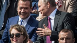 Russian President Vladimir Putin (R) speaks with Prime Minister Dmitry Medvedev during the City Day opening ceremony on the Red Square in Moscow, Russia, 09 September 2017.  EPA/YURI KADOBNOV / POOL