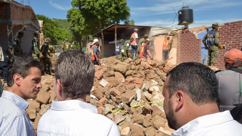 FILE PHOTO: A handout photo made available by the Presidency of Mexico shows Mexican President Enrique Pena Nieto (L) during his visit to the earthquake-affected town of Cintalapa, Chiapas, Mexico, 15 September 2017. Pena Nieto during his visit estimated that there are some 300,000 people whose homes have been damaged in the states of Chiapas and Oaxaca by an earthquake that hit the country on 07 September. According to the president there are already 120 companies that have expressed their intention to help in the reconstruction of the affected areas.  EPA, PRESIDENCY OF MEXICO HANDOUT, EDITORIAL USE ONLY