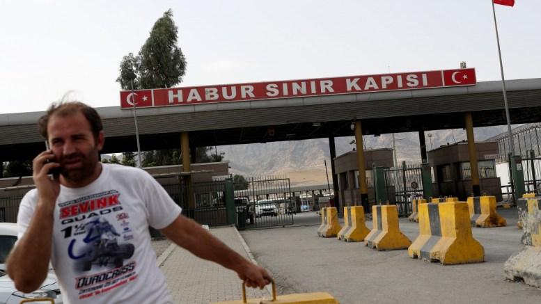 FILE PHOTO. A Kurdish man waits in front of the Habur border gate. EPA/SEDAT SUNA\