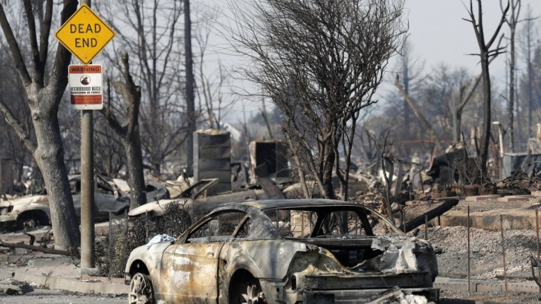 A burnt out car and destroyed homes in a cul de sac in Santa Rosa, California, USA, 12 October 2017. Multiple wildfires scattered throughout Napa, Sonoma and Mendocino counties, leaving at least 29 people dead and destroying homes and businesses in their path. EPA, JOHN G. MABANGLO