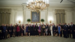 US President Donald J. Trump (C-L) and US First Lady Melania Trump (C-R) pose for an official photograph with senior military leaders and spouses in the State Dining room of the White House in Washington, DC, USA, 05 October 2017. President Trump and the First Lady are hosting the group for dinner in the Blue Room of the White House. EPA, ANDREW HARRER / POOL