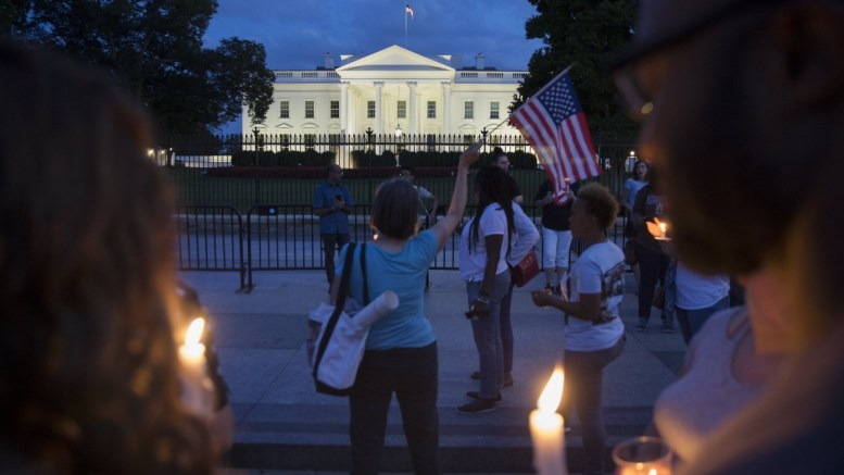 FILE PHOTO: People participate in a candlelight vigil after sunset on Pennsylvania Avenue outside the White House to show solidarity with the victims of the violence that took place this weekend at a white nationalist rally in Charlottesville, Virginia; in Washington, DC, USA. EPA, MICHAEL REYNOLDS