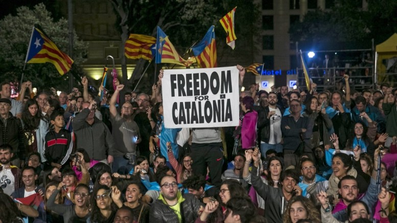 FILE PHOTO. People celebrate in Catalunya's square after the Catalonia independence referendum. EPA/SANTI DONAIRE