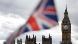 FILE PHOTO. The British Union flag is pictured in front of parliament in London, Britain. EPA, ANDY RAIN