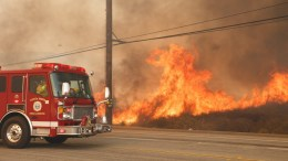 FILE PHOTO. A fire truck flees the wildfire flames in  California. EPA/EUGENE GARCIA