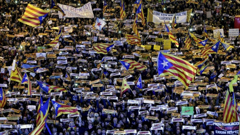 Demonstrators wave so-called 'Estelada', a flag usually flown by Catalonia independence supporters, and hold banners reading 'Freedom' during a rally to demand the release of former Catalonian regional ministers and social leaders imprisoned, in Barcelona, Spain, 11 November 2017. The rally was called by Catalonian pro-independence organizations ANC and Omnium Cultural.  EPA/Alberto Estevez