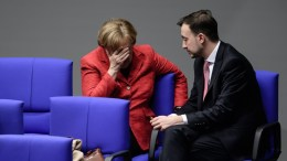German Chancellor Angela Merkel (L) of the Christian Democratic Union (CDU) and the chair of the CDU youth organization 'Junge Union' (JU), Paul Ziemiak (R), talk in one of the back benches during a session of the German 'Bundestag' parliament in Berlin, Germany, 21 November 2017. The German Bundestag gathered for the second time in the new legislative term. EPA, CLEMENS BILAN