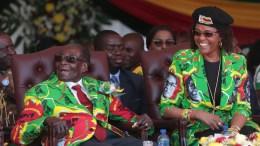 Zimbabwean President Robert Mugabe (L) and his wife Grace (R) smile after arriving at the Rudhaka Stadium in Marondera, about 100 kilometers east of Harare, Zimbabwe. EPA, AARON UFUMELI