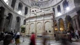 The tomb of Jesus Christ with the rotunda is seen in the Church of the Holy Sepulchre in Jerusalem's Old City. EPA/ABIR SULTAN