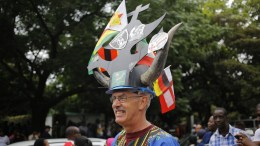 A man wears extrovert headgear as part of mass action protests that have brought the city to a stand still in Harare, Zimbabwe, 18 November 2017. The Zimbabwe National Army (ZNA) has taken over the control of the running of the country with Robert Mugabe, being under house arrest for days, but making his first public appearance at a University graduation ceremony on 17 November 2017.  EPA/KIM LUDBROOK