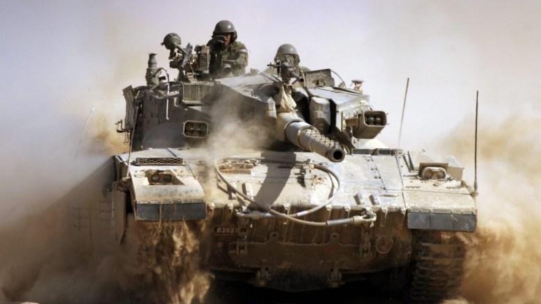 FILE PHOTO. An Israeli Merkava tank churns up dust. EPA/JIM HOLLANDER