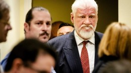 Bosnian Croat, Slobodan Praljak (R) enters the court in The Hague, The Netherlands, 29 November 2017, prior to the appeals judgement in the International Criminal Tribunal for the former Yugoslavia (ICTY), for war crimes committed during the bloody break-up of Yugoslavia. EPA/ROBIN VAN LONKHUIJSEN / POOL
