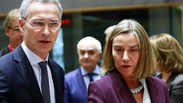FILE PHOTO. NATO Secretary General Jens Stoltenberg (L) and EU High representative for foreign policy Federica Mogherini (R) attends the EU Defence ministers council meeting with NATO. EPA/OLIVIER HOSLET