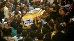People mourn around a casket of a female victim during the funeral for victims of an attack, at a church in the working-class suburb of Helwan, Cairo, Egypt, 29 December 2017. According to a press release by Egypt's Foreign Press Office, at least eight were killed, including the gunman and a policeman and six civilians, when a gunman attempted to storm Mar Mina Church in Helwan district EPA, AYMAN AREF