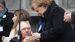 FILE PHOTO: German Chancellor Angela Merkel (R) and the President of the German Parliament Wolfgang Schaeuble (2-L) light a candle during at the commemorative events marking the first anniversary of the terrorist attack on Christmas market at Breitscheidplatz in Berlin, Germany, 19 December 2017. EPA, CLEMENS BILAN