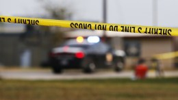 File Photo: Crime tape with a police car in background. EPA, LARRY W. SMITH