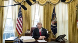 US President Donald J. Trump speaks to members of the news media while signing bills in the Oval Office of the White House in Washington, DC. EPA, MICHAEL REYNOLDS