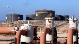 A file picture shows a general view of pipelines and oil storage tanks at Libya. EPA/STR