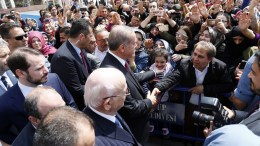 Turkish President Recep Tayyip Erdogan (C) shake hands with a man after praying at Eyup Sultan mosque with his son in lav, Energy Minister Berat Albayrak (back L) and Turkish parliamentary speaker Ismail Kahraman (front) in Istanbul, Turkey. EPA, SEDAT SUNA