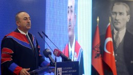 Foreign Minister of Turkey Mevlut Cavusoglu speaks during the ceremony of receiving the honorary title 'Honoris Causa' from the Rector of the University Mehmet Akif Ersoy Adem Korkmaz in Tirana, Albania. FILE PHOT.  EPA/MALTON DIBRA