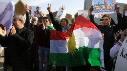Protesters shout slogans and hold placards during a demonstrators against the military operation by the Turkish army against the Kurdish YPG forces in Syria's Afrin, in front of the Kurdistan Parliament in Erbil, Kurdistan Region of Iraq, 21 January 2018. EPA, GAILAN HAJI