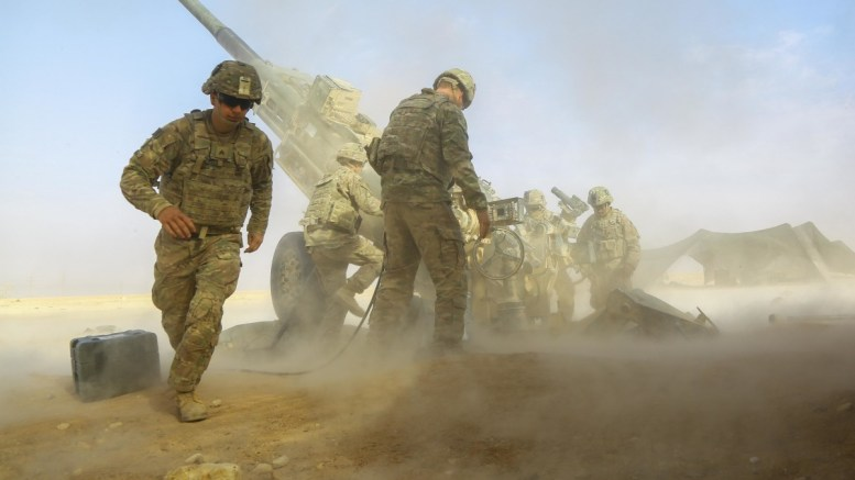 File Photo: U.S. Army soldiers assigned to 5-25 Field Artillery, Charlie Battery, 2nd Platoon fires a Howitzer M-777 A2 provides fire support. U.S. Army photo by Spc. William Gibson, CENTCOM.