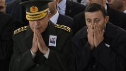 Chief of Staff General Hulusi Akar (L) and people pray near by the coffin of Turkish pilot Lieutenant Resul Ekrem Gokdogan who was killed in a jet crash in Izmir on 16 February, during a funeral ceremony in Ankara, Turkey, 17 February 2018. EPA, TUMAY BERKIN