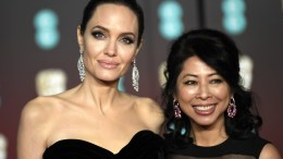 US actress Angelina Jolie (L) and Cambodian-born US writer and producer Loung Ung (R) arrives ahead of the 71st annual British Academy Film Awards at the Royal Albert Hall in London, Britain, 18 February 2018. The ceremony is hosted by the British Academy of Film and Television Arts (BAFTA). EPA, NEIL HALL