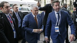 Turkish Prime Minister Binali Yildrim (C) arrives at the 'Bayerischer Hof' hotel, the venue of the 54th Munich Security Conference (MSC), in Munich, Germany. EPA, RONALD WITTEK