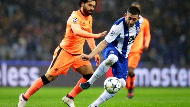 FC Porto's Hector Herrera (R) in action against Liverpool's Mohamed Salah (L) during the UEFA Champions League round of 16, first leg soccer match between FC Porto and Liverpool FC at Dragao stadium in Porto, Portugal, 14 February 2018. EPA, JOSE COELHO