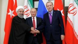 Russian President Vladimir Putin (C), Iranian President Hassan Rouhani (L) and Turkish President Recep Tayyip Erdogan (R) shake hands during their meeting in the Black sea resort of Sochi, Russia, 22 November 2017. EPA, MICHAEL KLIMENTYEV, SPUTNIK, KREMLIN