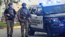 FILE PHOTO. Two SWAT officers walk in front of the side entrance of the Marjory Stoneman Douglas High School after a shooting in Parkland, Florida, USA. EPA, CRISTOBAL HERRERA