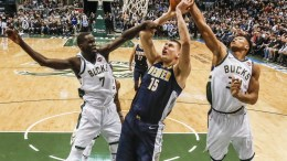 Denver Nuggets center Nikola Jokic of Serbia (C) shoots between Milwaukee Bucks center Thon Maker of Australia (L) and Milwaukee Bucks forward Giannis Antetokounmpo of Greece (R) in the first half of their NBA game at the BMO Harris Bradley Center in Milwaukee, Wisconsin, USA. EPA, TANNEN MAURY SHUTTERSTOCK OUT