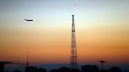 An Iranian air plane passes alongside a colourful sunset illuminating the sky over the Iranian capital Tehran, Iran. FILE PHOTO. EPA, ABEDIN TAHERKENAREH