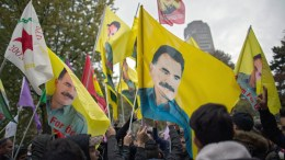 Kurdish activists show banners with portraits of jailed PKK founder Ocalan and shout slogans as they protest the ongoing Turkish military operation in the Syrian city of Afrin at Ebertplatz in Cologne, Germany. Turkish troops launched a military operation named 'Operation Olive Branch' in Syria's northern regions. EPA, STRINGER