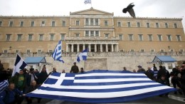 Protesters hold a huge Greek flag in front of the Greek Parliament, during a massive rally over the name of the FYROM against to its use of the name 'Macedonia' amid a revival of efforts to find a solution between the two countries, in Athens, Greece, 04 February 2018. EPA, ALEXANDROS VLACHOS