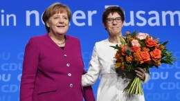 File Photo: German Chancellor Angela Merkel (L) and Annegret Kramp-Karrenbauer (R), newly elected Christian Democratic Union (CDU) General Secretary, during the 30th party convention of the CDU in Berlin, Germany, 26 February 2018.  EPA, CLEMENS BILAN
