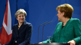 German Chancellor Angela Merkel (R) and British Prime Minister Theresa May (L) address the media during a joint press conference after their meeting at the Chancellery in Berlin, Germany, 16 February 2018. At a joint meeting they discussed about European issues including the euro-exit of Britain and international issues. EPA, MARKUS HEINE