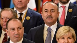 Turkish Foreign Minister Mevlut Cavusoglu attends the Kuwait International Conference for the Reconstruction of Iraq, 13 February 2018. EPA, Noufal ibrahim
