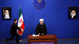 An official runs to adjust the seat of Iranian President Hassan Rouhani during a press conference in Tehran, Iran, 06 February 2018. Media reported Rouhani saying that US President can not tear up the nuclear deal and our defence system are unnegotiable. EPA, ABEDIN TAHERKENAREH