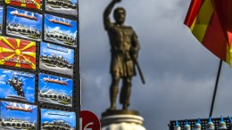 The monument of Greek King Filip II of Macedonia is seen behind a souvenir's shop in the center of the capital Skopje, The FYROM, 14 February 2018. The Fyromian public eagerly awaits the outcome of the intensive negotiations between the FYROMian and Greek governments regarding the problem of the name of the country. EPA, GEORGI LICOVSKI