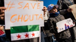 People carry posters which read 'save Ghouta' and flags of the Syrian National Coalition during a protest to demand an immediate cease-fire in Eastern Ghouta, Syria, on the 'Place de la Republique' in Paris, France, 25 February 2018. EPA, CHRISTOPHE PETIT TESSON