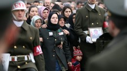 FILE PHOTO. Gamze Mehmethan (C), wife of Fatih Mehmethan, a Turkish soldier who was killed in a cross-border clashes with Kurdish Popular Protection Units (YPG) forces at Afrin, during a funeral ceremony in Istanbul, Turkey. EPA, ERDEM SAHIN