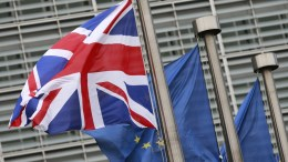 FILE PHOTO. British and European flags in front the European Commission headquarters during a meeting of British Prime Minister Theresa May and President Jean-Claude Juncker on Brexit Negotiations. EPA, OLIVIER HOSLET