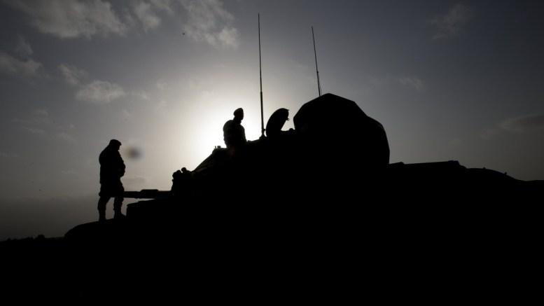 File Photo: Turkish soldiers prepare their tanks before crossing the Syrian-Turkish border, at the Hassa district on the Turkish-Syrian border in Hatay, Turkey. EPA, SEDAT SUNA